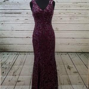 Purple sequin floor length mermaid gown